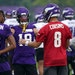 Vikings wide receivers Adam Thielen (19), Justin Jefferson (18), and Bisi Johnson (81) listened as Vikings quarterback Kirk Cousins (8) talked through