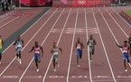 Andre De Grasse, of Canada races to win the gold medal. Joseph Fahnbulleh, second from left, finished fifth.