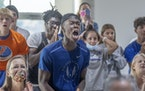 Alvin George, 19, reacted as he and other students watched Joe Fahnbulleh run the 200-meter final at a viewing party at the Hopkins High School cafete