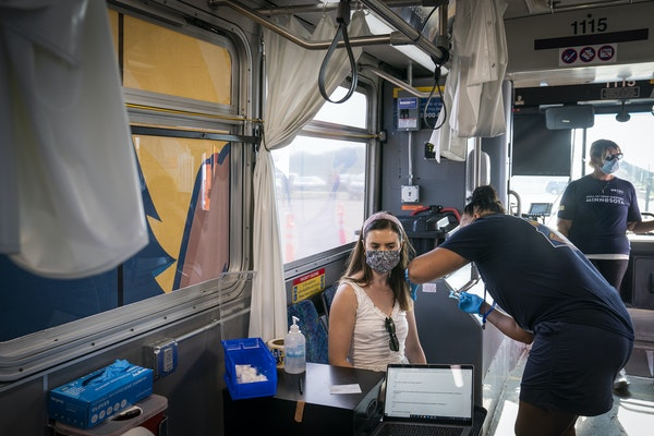 Maddie Tompkins, 29, of Chaska, received a COVID-19 vaccine last month during a mobile vaccination event at Chanhassen High School.