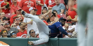 Twins first baseman Miguel Sano fell into the safety net as he tried to catch a foul ball Wednesday.