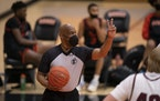 Referee Lamarr Sullivan wearing a mask during a basketball game in February. The state high school league is monitoring growing number of mask mandate