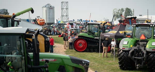 Folks gathered to talk and get a look at the equipment offerings at the Ziegler Ag Equipment display at Farmfest 2021.