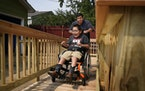 Marshall Wanstall, 8, who has cerebral palsy and uses a wheelchair, got the chance to try out his new wheelchair ramp, built by volunteers from Rebuil