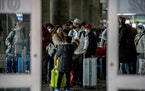 Travelers at John F. Kennedy International Airport, which is served by Delta, in New York on Friday, Jan. 31, 2020.