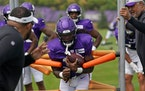 Vikings running back Dalvin Cook (33) carried the ball as he ran drills during training camp Wednesday.