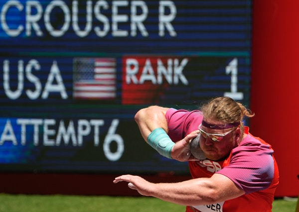 The United States' Ryan Crouser set an Olympic record on his first throw — and then kept resetting it throughout the competition — to win the go
