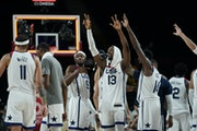 United States players celebrated their 97-78 victory over Australia in the men's basketball semifinals game against Australia at the 2020 Summer Oly