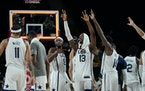 United States players celebrate their win in the men's basketball semifinal game against Australia at the 2020 Summer Olympics