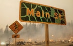 A street sign stands in central Greenville as the Dixie Fire tears through Plumas County, Calif., on Wednesday, Aug. 4, 2021.