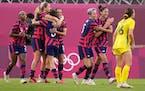 Carli Lloyd, center, celebrates scoring her side's 4th goal against Australia with teammates during the women's bronze medal soccer match.