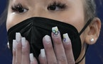 Suni Lee's Minneapolis-created acrylic nails were in clear view as she awaited final results of the women's all-around gymnastic competition in To