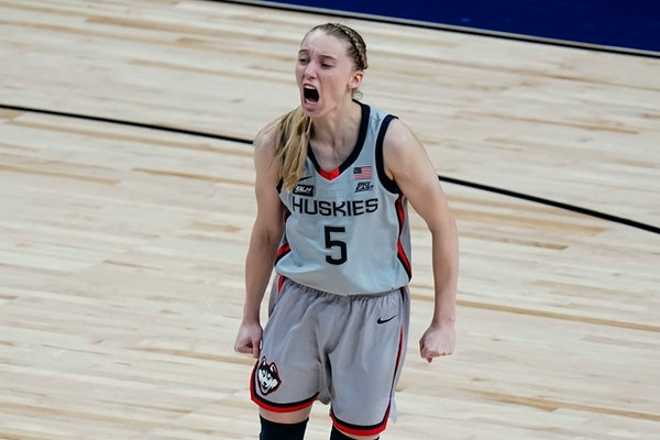 UConn guard Paige Bueckers (5) celebrates a score against Baylor during the second half of a college basketball game in the Elite Eight round of the w