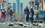 "Margot Robbie, Daniela Melchior, Idris Elba and David Dastmalchian in ""The Suicide Squad.""  Warner Bros. )"