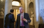 Sen. Lindsey Graham, R-S.C., leaves the chamber as the Senate advances to formally begin debate on a roughly $1 trillion infrastructure plan, a proces
