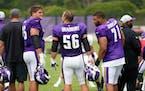 Minnesota Vikings tackle Brian O'Neill,left, center Garrett Bradbury, center, and rookie Christian Darrisaw chat during the NFL football team's tr