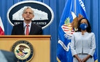 Attorney General Merrick Garland, accompanied by Assistant Attorney General for Civil Rights Kristen Clarke, speaks at a news conference at the Depart