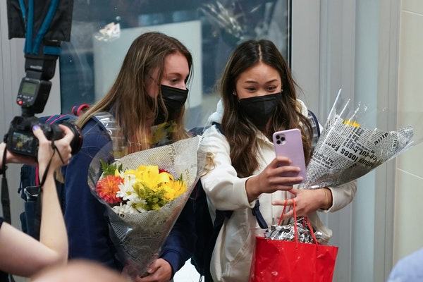 Suni Lee took a selfie with teammate Grace McCallum after arriving at Minneapolis-St. Paul International Airport to cheering fans Thursday afternoon.