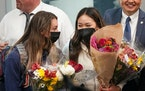 Minnesota gymnasts Grace McCallum and Suni Lee arrived at Minneapolis St. Paul International Airport to hundreds of cheering fans.