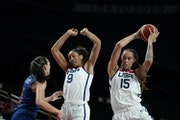 United States' Brittney Griner (15) drives around Serbia's Sonja Vasic (5), left, during women's basketball semifinal game at the 2020 Summer Olympics