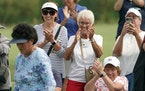 The gallery's got her back World Golf Hall of Famer Nancy Lopez, foreground, was a can't-miss sighting Friday in the 46-player field at the Land O