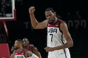 Kevin Durant celebrates after a basket during the men's basketball gold medal game against France at the 2020 Summer Olympics