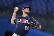 Nick Martinez of the USA pitched during the first inning of the gold medal baseball game against Japan at the 2020 Summer Olympics on Saturday in Yoko