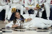 Brittney Griner posed with her gold medal after Team USA beat Japan in dominant fashion for the Olympic women's basketball championship.
