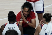 Coach Dawn Staley talked to Team USA during the women's basketball gold medal game against Japan on Sunday in Saitama, Japan.