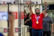 Returning home with a gold medal from the Tokyo Olympics, Gable Steveson greeted fans after arriving at Minneapolis-St. Paul International Airport on