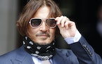 Johnny Depp arrives at the High Court in London, Friday, July 17, 2020.