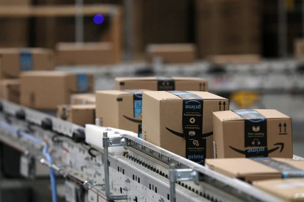 Packages passed down a conveyor belt before receiving a shipping label at Amazon's fulfillment center in Shakopee.