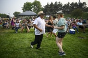 Ruban Urrutia and Jennifer Gerboth, both from Minneapolis, danced at a Malamanya concert.