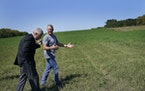 """Agriculture Secretary Tom Vilsack, left, walked with farmer William """"Chip"""" Callister Thursday in what should be a knee-high third crop of alfalfa"""