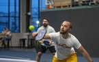Zach Peterson returned a shot as he and Matthew Reid played in the pickleball league hosted by Minneapolis Cider Co.