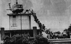 April 29, 1975: Evacuees climbed a ladder to a U.S. helicopter on top of a downtown Saigon building.