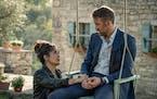"Salma Hayek, left, and Ryan Reynolds in ""The Hitman's Wife's Bodyguard."""