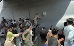 Thousands of Afghans rushed onto the tarmac at the airport in Kabul on Monday, some so desperate to escape the Taliban capture of their country that t