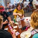 """Hanna Dryden, center, plays bingo with fellow Cornerstone Village residents and their families during bingo night. """"I think this community is really"""