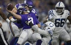 Indianapolis Colts defensive end Ben Banogu (52) forced an incomplete pass by Minnesota Vikings quarterback Jake Browning (3) in the second quarter.