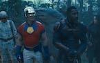 "John Cena, Idris Elba and Daniela Melchior  in ""The Suicide Squad."""