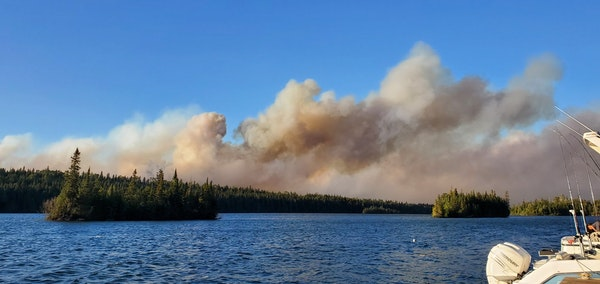 View from a fishing boat of an Isle Royale wildfire.