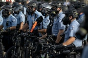 Police lined up against protesters two days after the police killing of George Floyd, near the department's Third Precinct headquarters.