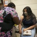 Registered nurse Yvonne Akufongwe gave Jennifer Gutierrez, 15, her second Pfizer shot at a vaccination clinic last week.