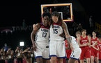 United States's Sylvia Fowles (13) celebrates helium  4th  vocation  Olympic golden  medal.