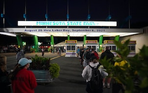 A line formed outside the main gates of the Minnesota State Fair early on Thursday, Aug. 26, 2021.