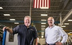 Aggressive Hydraulics CEO Paul Johnson, left, with Roger Hamilton of BankCherokee at Aggressive Hydraulics in East Bethel.