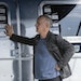 Actor Tom Hanks with his 34-foot Airstream travel trailer. It was one of four vehicles from his private collection that were sold at auction. The 1992