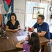 Asuka Kakitani and JC Sanford were interrupted by their cat Sora while spending time with their daughter playing a card game at home in Northfield.