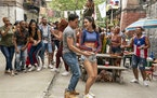 """Anthony Ramos, left, and Melissa Barrera in Jon M. Chu's """"In the Heights,"""" based on Lin-Manuel Miranda's hit Broadway musical."""